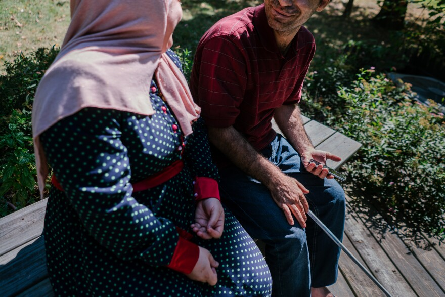 Ghada and Osama sit on their deck in their new home in Princeton, N.J. Their family has been resettled from Syria and is being sponsored by the Nassau Presbyterian Church. Due to security concerns we are only including first names.