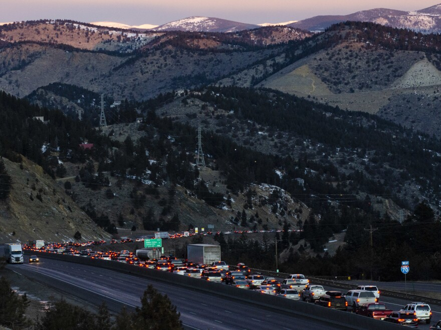 Interstate 70 west of Denver is backed up with ski traffic on Jan. 18. Coloradans make this powder pilgrimage every weekend, and traffic has gotten worse.