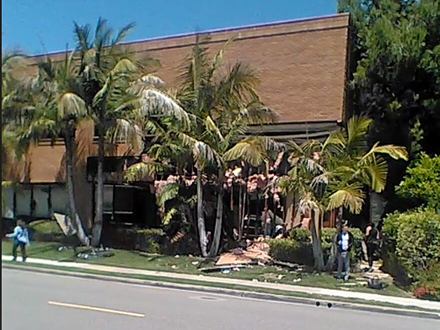 This image taken from cellphone video shows a building after a fatal explosion in Aliso Viejo, Calif., on Tuesday. The cause of the blast is being investigated.