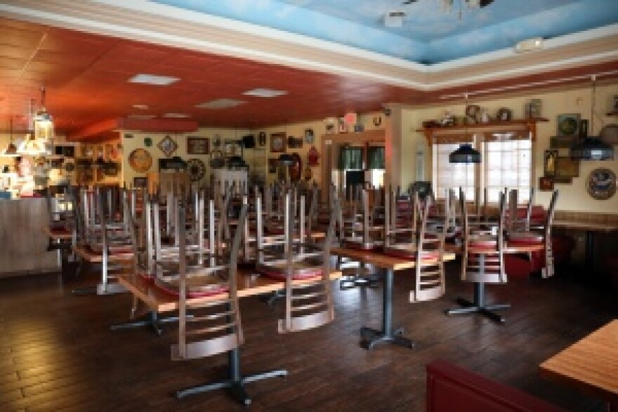 Chairs turned up in the dining room