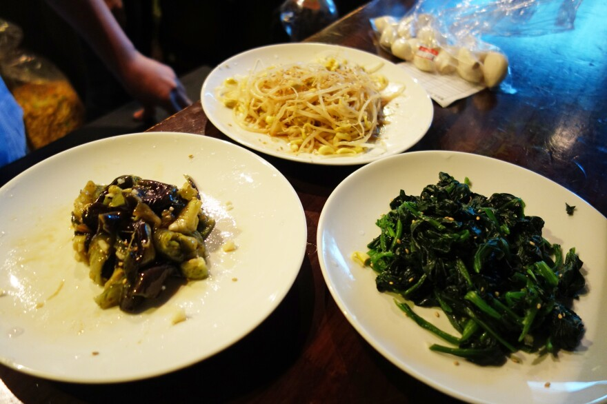 """Three plates of <em>banchan</em> — bean sprouts, eggplant and spinach --€"""" took only 17 minutes to prepare."""