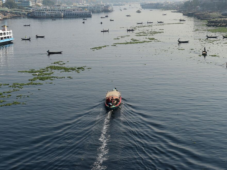 Bangladeshi commuters use boats to cross the Buriganga River in the capital Dhaka in 2018. In July, Bangladesh's top court granted all the country's rivers the same legal rights as humans.