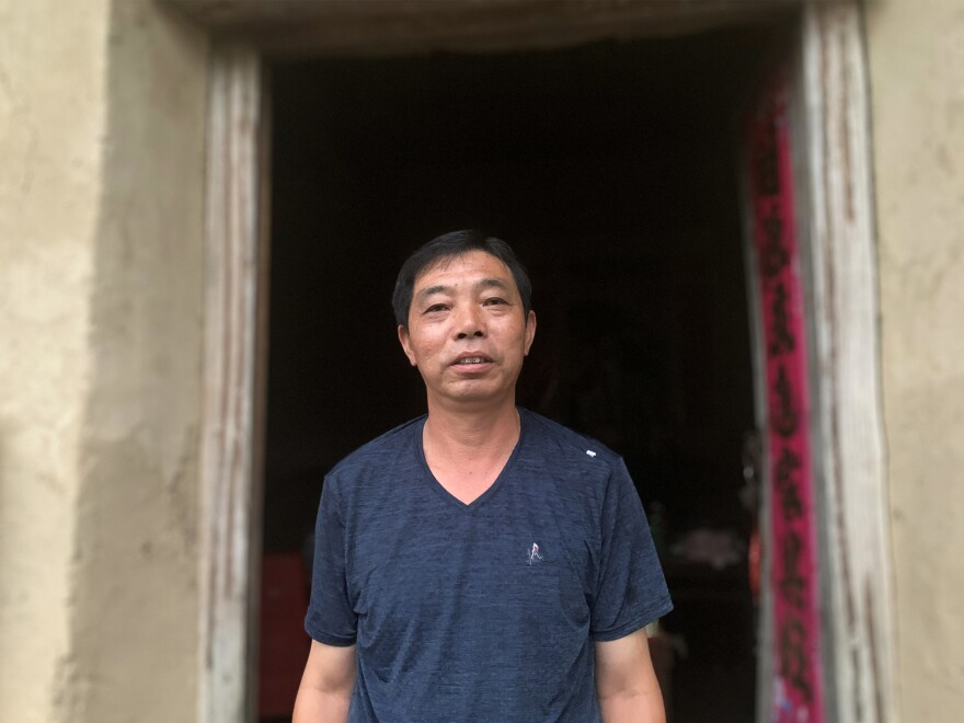 Zeng Hailin stands in front of his dilapidated home. During flash flooding in his Anhui village last month, he evacuated his 80-year-old mother by floating her out in a plastic washbasin.
