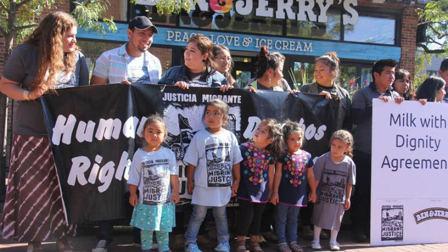 Migrant Justice activists gather to celebrate the signing of an agreement with Ben & Jerry's that took two years to negotiate.