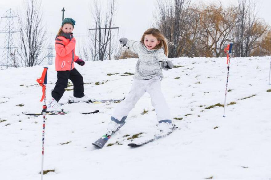8-year-old Scarlett Chetwood, right, and her twin sister, Vivian, practice their slalom skills on a neighborhood berm before their first ski trip to Bogus Basin this year.