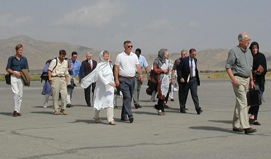 Diplomats and family members of the detained aid workers walk to their plane at Kabul airport to leave for Pakistan on Sept. 13, 2001. John Mercer, father of one detained aid worker, is in the white shirt in the center. The few foreigners in Afghanistan left the country after the Sept. 11 attacks in the U.S. The Taliban said they could not guarantee their safety.