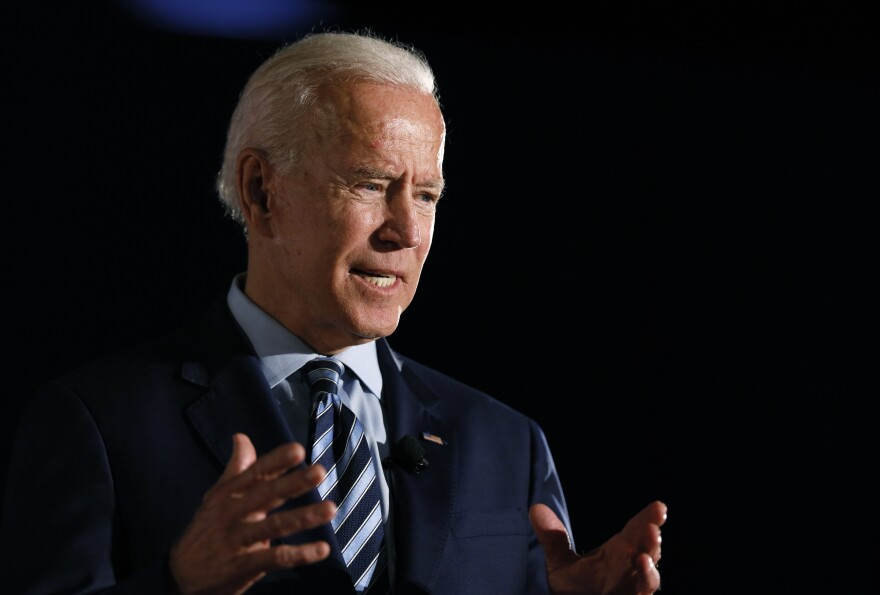 Former Vice President Joe Biden speaks during a presidential candidates forum sponsored by AARP and <em>The Des Moines Register</em> on Monday in Des Moines, Iowa.