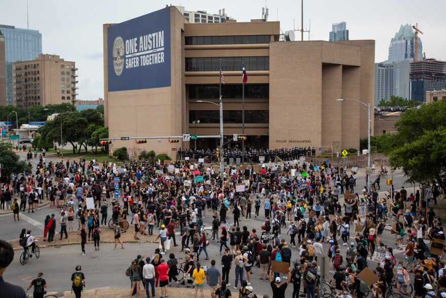 People gather at Austin Police Department's headquarters on Sunday to protest police violence against black people.
