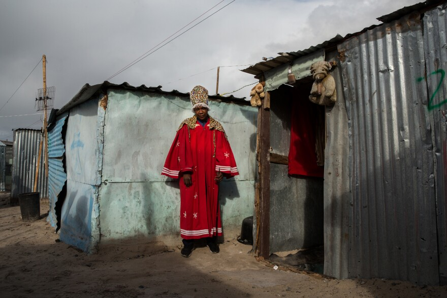 """Masakhe Nolakoza, a traditional healer, has lived in Covid since early April. He previously lived in a shack in someone's backyard in Mfuleni, the neighboring township. His business has not been good in the new location. """"People are losing hope and only thinking of basics for now,"""" he said."""