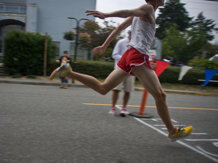 A runner crosses the finish line.