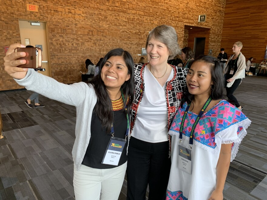 Helen Clark, former prime minister of New Zealand and gender equality champion, takes a selfie with attendees of the Women Deliver conference in Vancouver.