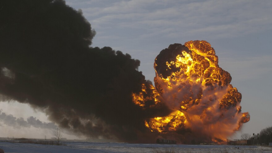 A fireball goes up at the site of an oil train derailment in Casselton, N.D., in this Dec. 30 photo. The fiery crash left an ominous cloud over the town and led some residents to evacuate.