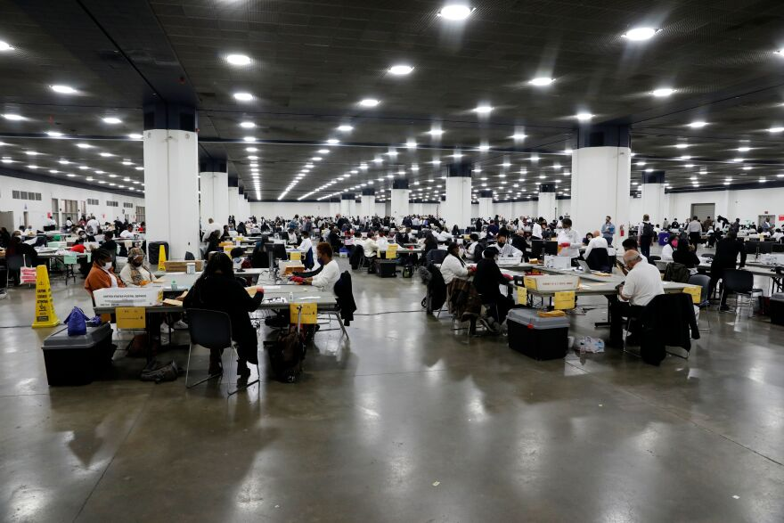 Election workers work on counting absentee ballots for the 2020 general election at TCF Center on Nov. 4, 2020 in Detroit.