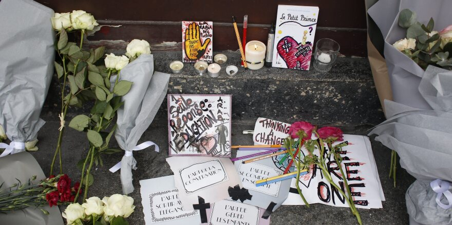 Impromptu memorials for the victims of Friday's terrorist attacks have been started all over Paris. Some mourners express both sorrow for the dead and concern over a potential backlash against French Muslims.