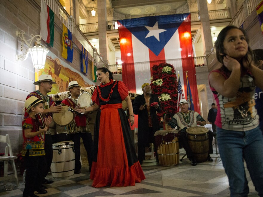A musical group playing traditional Puerto Rican bomba music performs at a parranda in Hartford, Conn.