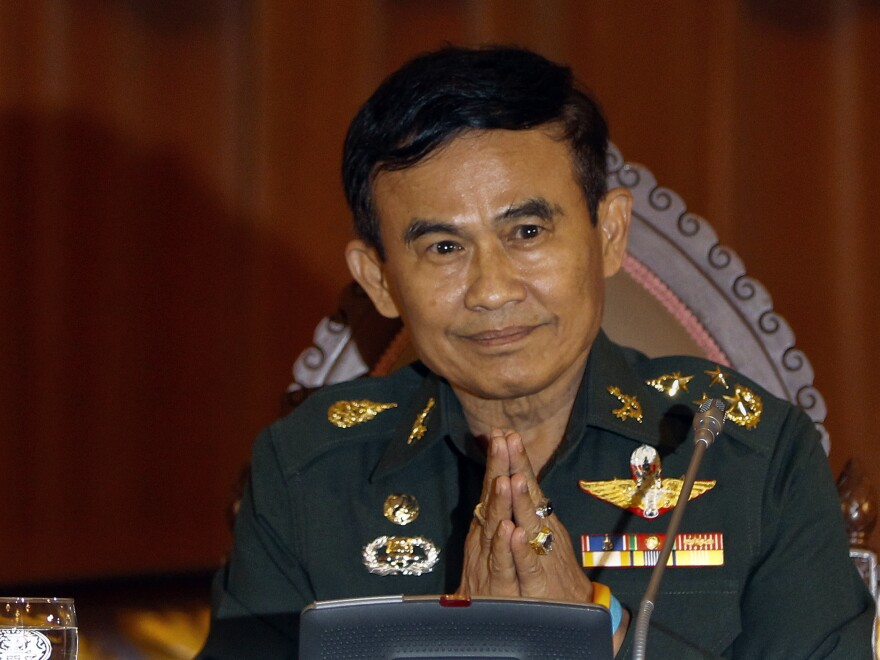 "Thailand's Justice Minister Gen. Paiboon Koomchaya tells Reuters that martial law will remain in place ""indefinitely."""