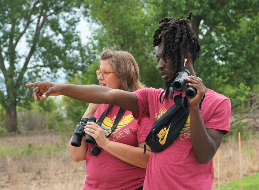 Kemet Ajanaku, right, spots an egret near the Audubon Center at Riverlands on July 1, 2019. Teens learn the basics of environmental conservation, then lead a series of summer camps for elementary schoolers.