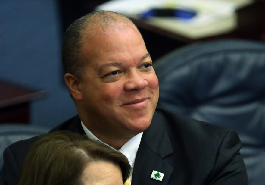 Rep. Mike Hill smiles during the 2016 legislative session