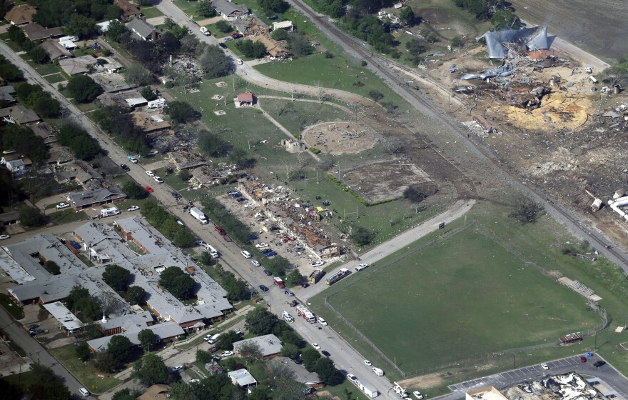 This April 18, 2013 aerial file photo shows the remains of a nursing home, left, apartment complex, center, and fertilizer plant, right, destroyed by an explosion at a fertilizer plant in West, Texas.