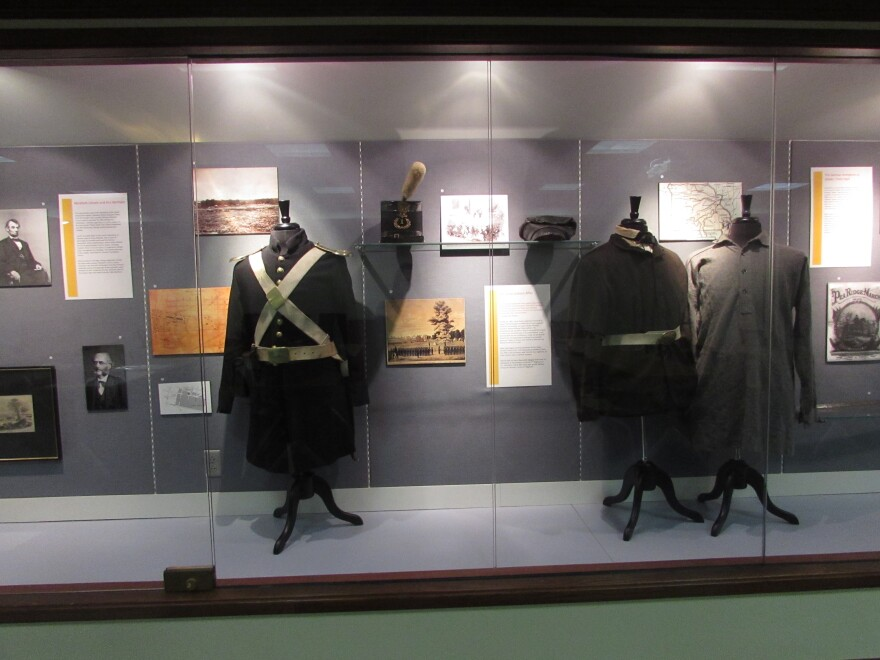 Civil war uniforms and civilian clothing are on display at the SLU exhibit on 19th-century abolitionist Germans.