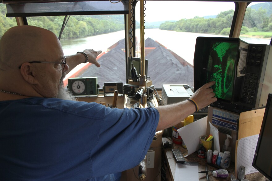 Captain Marvin Wooten pushes five loads of coal along the Kanawha River. He has worked for Amherst Madison since 1979.