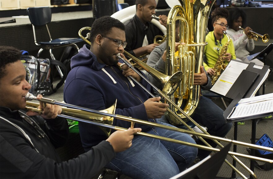 Tyrese Whitfield, center, plays trombone. (Jan. 17, 2017)