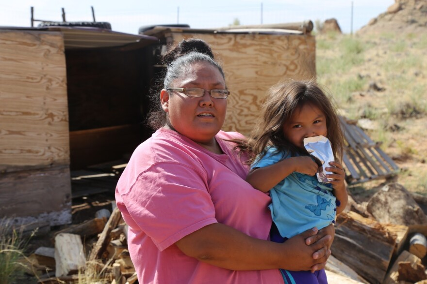 A Navajo woman holds her daughter