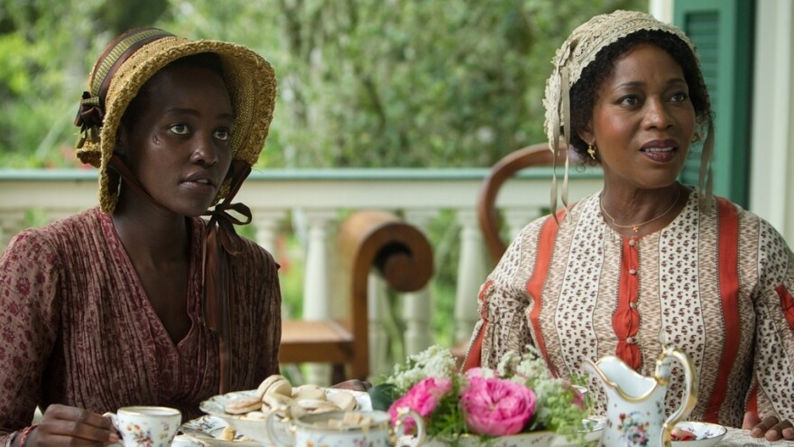 Alfre Woodard as Mistress Harriet Shaw and Lupita Nyong'o as Patsey in <em>12 Years a Slave. </em>