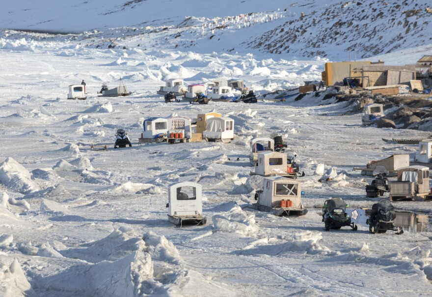 As spring camping season approaches, the shoreline of Arctic Bay becomes a parking lot for qamutiks — traditional sleds that family members will fill with gear and food for extended trips for hunting and camping.