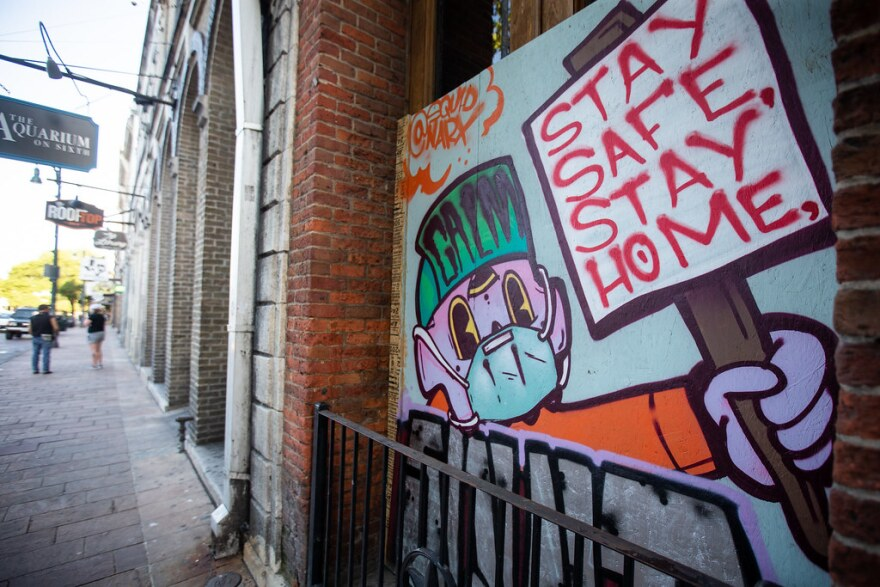 A mural on a business on Sixth Street tells people to stay home and stay safe.
