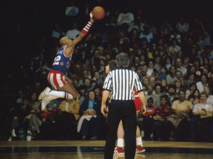"Harlem Globetrotters' Fred ""Curly"" Neal, shown here during a 1975 game, was known as a master dribbler."