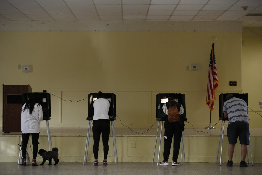 Voters fill out their ballots at the Legion Park polling station in Miami, on Election Day, Tuesday, Nov. 3, 2020.(AP Photo/Rebecca Blackwell)
