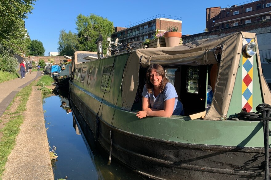 """Michelle Madsen, a poet, theater producer and journalist, on her canal boat in East London. Madsen enjoys boat living, but the lockdown at times brought challenges. """"I felt as if I was just being surrounded by this fug of COVID,"""" she says, """"everybody running past, just coughing and spitting and sweating, desperate to beat their personal best. I felt imprisoned, really."""""""