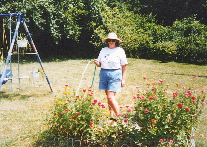 Amy Papian, shown in this photo from 1996, loved spending time in her yard on Wilson Avenue in University City. But after a neighbor's body washed up behind her home during a flash flood in 2008, Papian and her daughters stopped using the backyard.