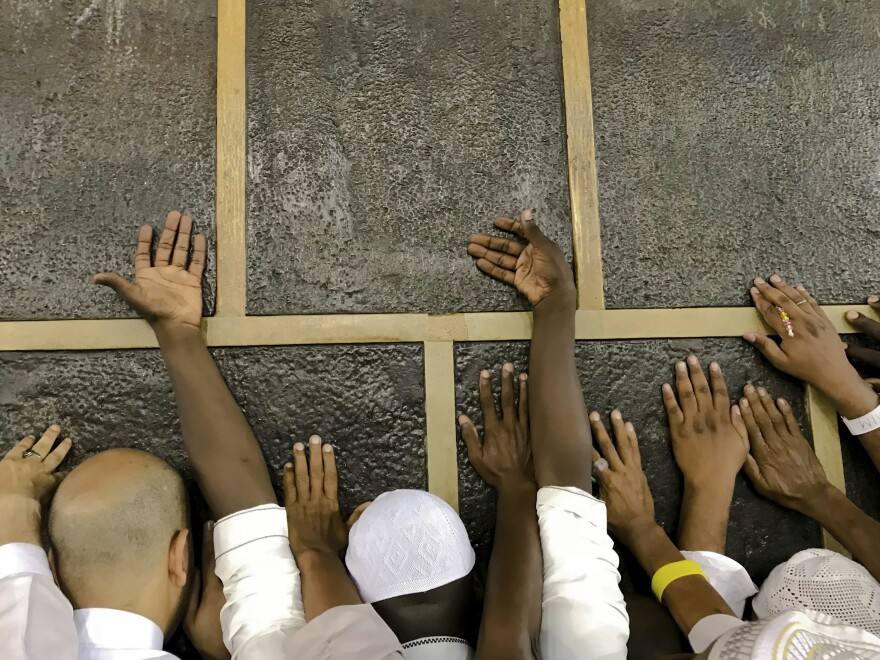 Muslim pilgrims touch the Kaaba stone, the cubic building at the Grand Mosque in Mecca. The hajj begins on Sunday and lasts through Friday, Aug. 24.