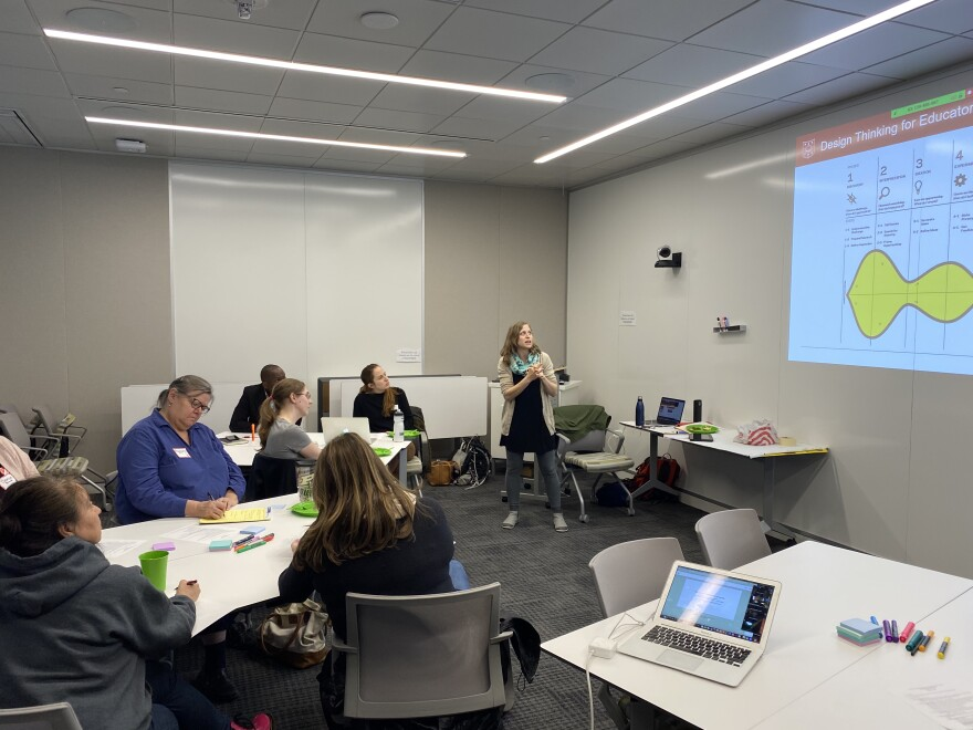 K-12 Climate Across Curriculum program coordinator Alex Morales-Heil engages teachers from all over the area on how to address climate change in the classroom in 2019.