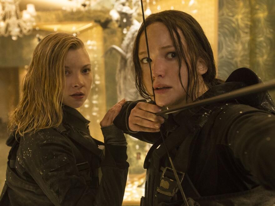 Jennifer Lawrence (shown with Natalie Dormer, left) received archery training for her role in the<em> Hunger Games</em> series.