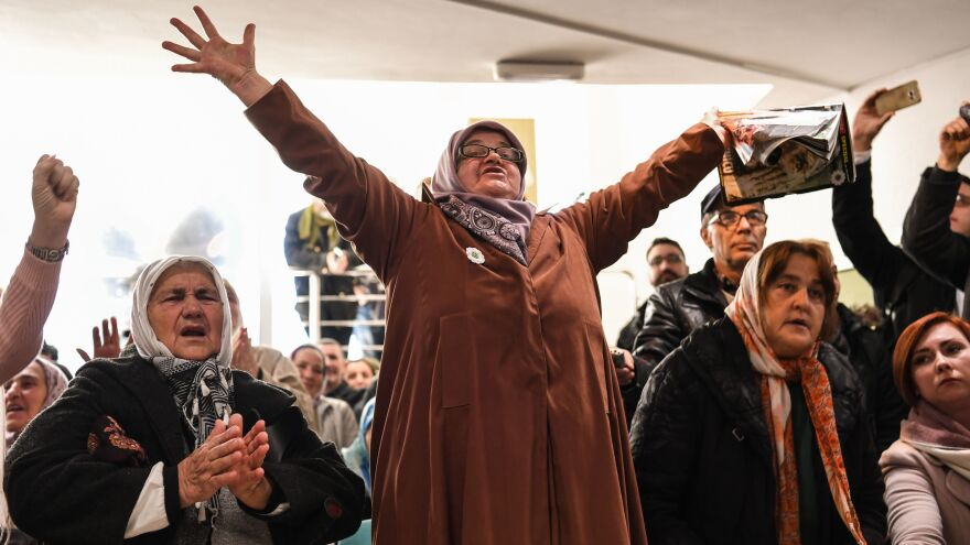 People celebrate as they watch a live TV broadcast on Wednesday in Srebrenica, when U.N. judges announce the life sentence in the trial of former Bosnian Serb commander Ratko Mladic, accused of genocide and war crimes in the brutal Balkans conflicts over two decades ago.