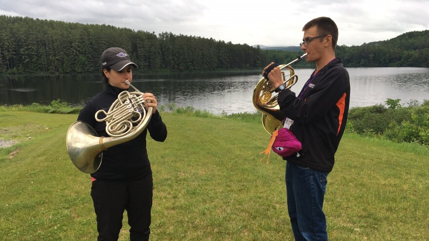Camp staffer Abby Martin (left) and veteran camper Torrin Hallett (right) play their horns at the Kendall Betts Horn Camp.