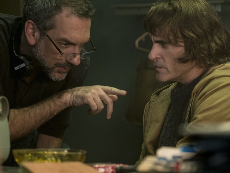 Director and co-writer Todd Phillips consults with Joaquin Phoenix on the set of <em>Joker</em>. Phillips' previous directing credits include <em>Old School</em> and the <em>Hangover</em> movies.
