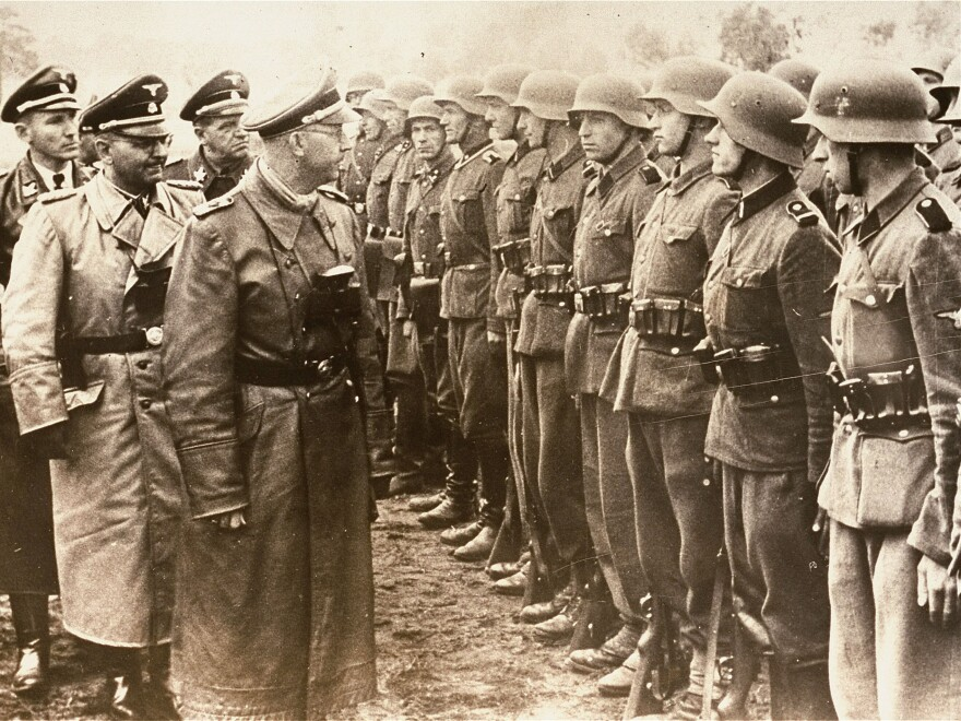 A June 3, 1944, photo provided by the U.S. Holocaust Memorial Museum shows SS chief Heinrich Himmler (center) as he reviews troops of the Galician SS-Volunteer Infantry Division.