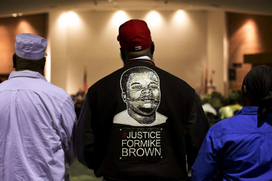 Michael Brown Sr. stands at the back of the Ferguson Community Center's event space during the public comment portion of a 2016 Ferguson city council meeting.