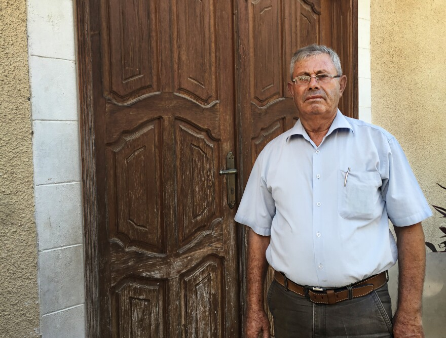 Mohammad Sultan stands outside the locked door of a children's clinic in Gaza City. Sultan ran the clinic for World Vision, which temporarily closed the center after its Gaza director was accused of diverting humanitarian assistance to Hamas.