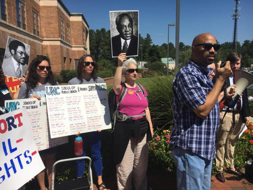 Supporters of the UNC Center for Civil Rights protest outside of a committee meeting of the UNC Board of Governors meeting on August 1, 2017.