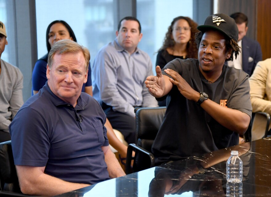 NFL commissioner Roger Goodell and Jay Z at Roc Nation's Manhattan headquarters on August 14, announcing a partnership between the sports league and the rapper's entertainment company.