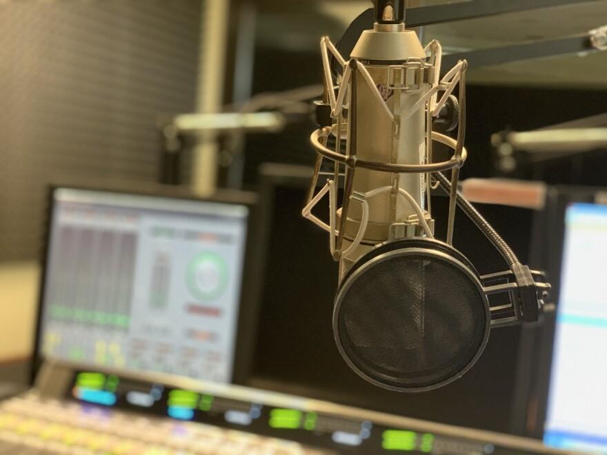a microphone in a recording studio
