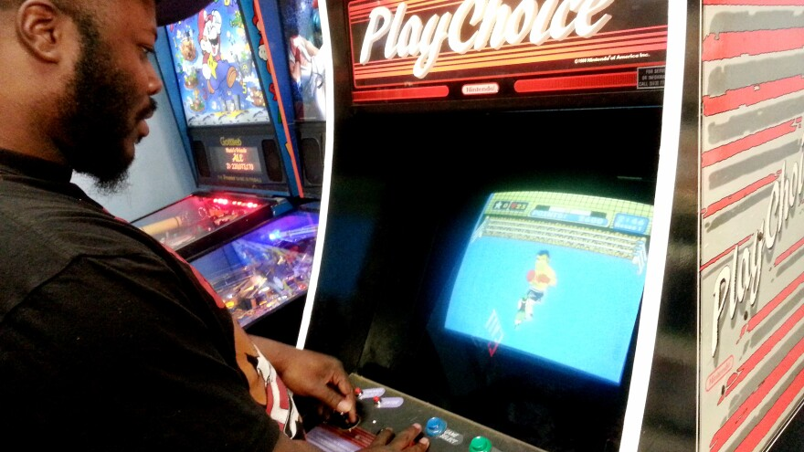 Cameo Stevens, 35, plays Mike Tyson's Punch-Out! at Save Point Video Games in Charlotte, N.C. The market for old video games of the '80s and '90s has seen a surge in recent years.