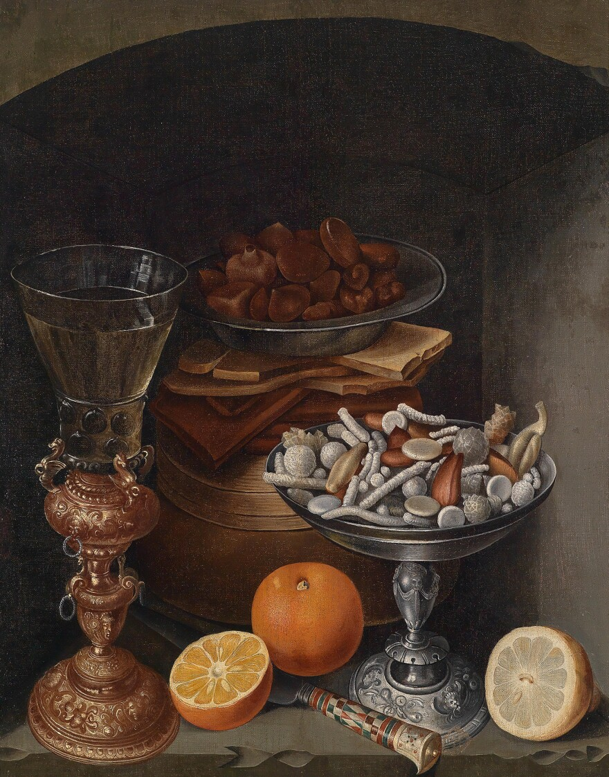"""Still life with a bowl of candies and comfits, likely done in the 17th century. The landed gentry and even well-fed merchants could show off their wealth with a banquet of conserves and comfits – a candy made of a nut or seed coated in sugar. In <em>The Merry Wives Of Windsor</em>, Falstaff calls for """"kissing comfits"""" to fall from the sky."""
