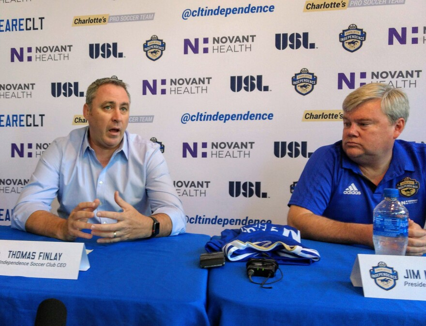 Thomas Finlay, left, of the Carolina Rapids and Jim McPhilliamy, owner of the Charlotte Independence professional soccer team, announced the creation of a new youth to professional club in the Charlotte region.