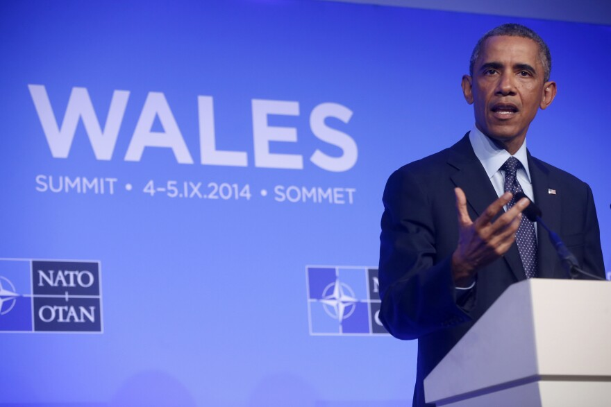 President Barack Obama speaks at a news conference at the NATO summit at Celtic Manor, Newport, Wales, on Friday.